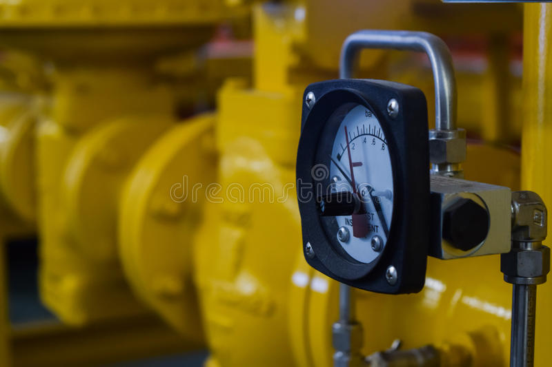 Close up of industrial pipes and measurer stock image