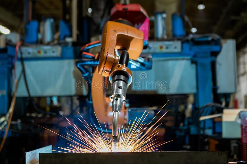 Close-up industrial robot is welding in a car factory stock photography