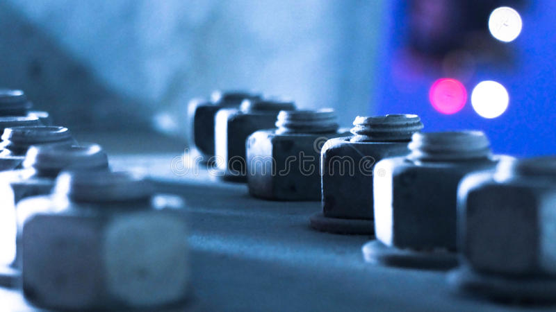Close up of Industrial structure joint with many screws and bolts royalty free stock photos