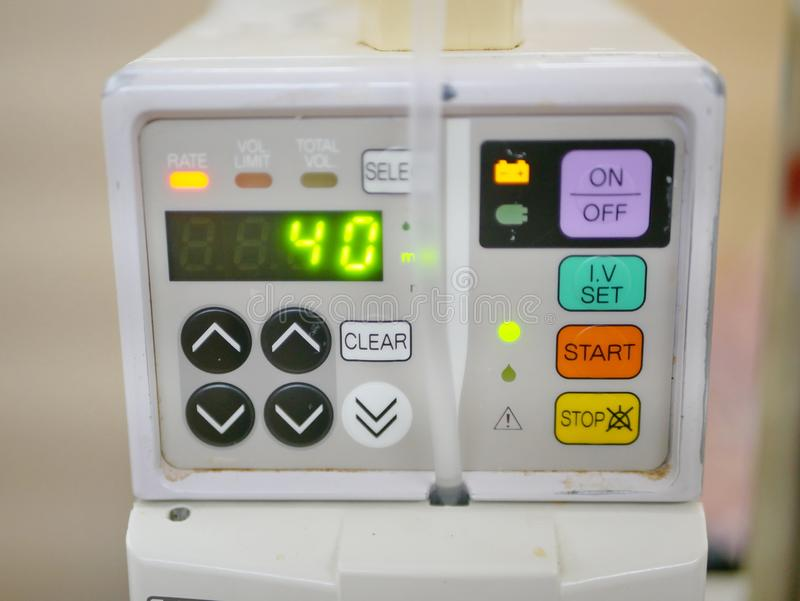 An infusion pump infusing fluids and nutrients into a circulatory system of a patient. Close up of an infusion pump infusing fluids and nutrients into a royalty free stock images