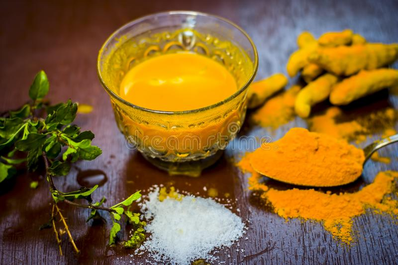 Close up of ingredients of ayurvedic treatment of cough i.e. turmeric,Curcuma longa,salt,sodium chloride,and oil. royalty free stock image