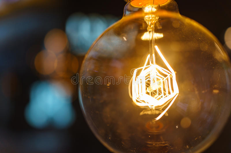 Close up innovation illuminated light bulb with bokehs as creat stock images
