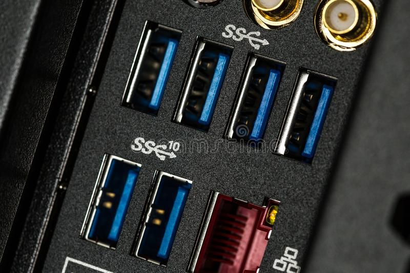 Close up of input output panel in the back of a computer with USB 3.0 ports royalty free stock photography
