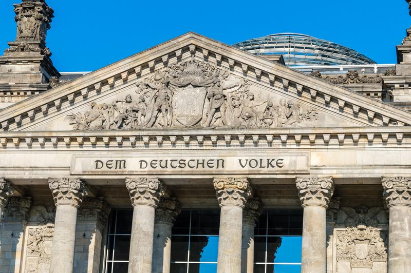 Close-up for inscription Dem Deutschen Volke English: To the German people at Reichstag building. Berlin, Germany - August 16, 2018: Close-up for inscription stock photos