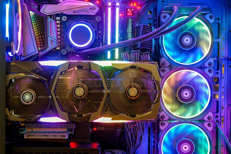 Inside Desktop PC Gaming and Water Cooling CPU with LED RGB light show status on working mode. Close-up and inside Desktop PC Gaming and Water Cooling CPU with royalty free stock images