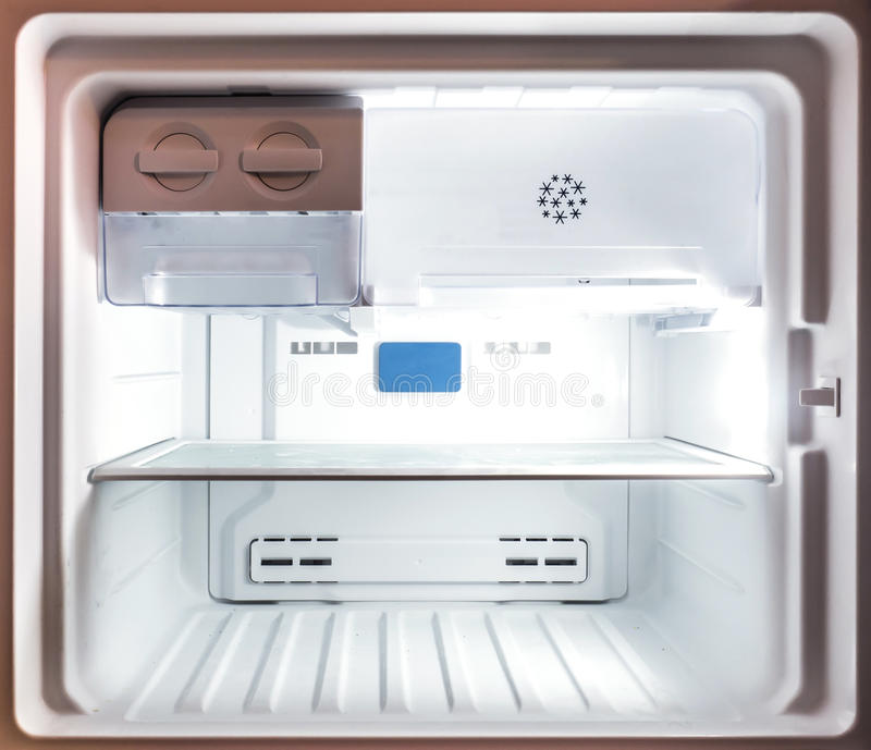Close up inside an empty white freezer fridge stock image