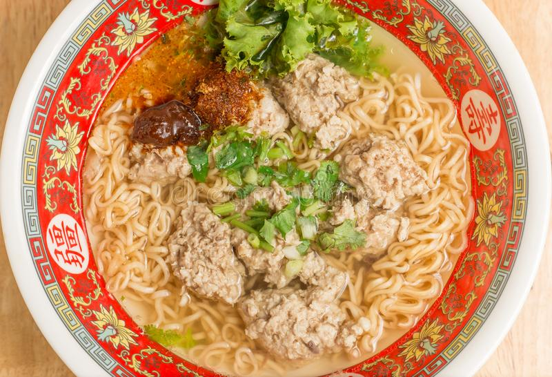 Close up of Instant noodle with meat ball and green Coriander on wood table. Close up of Instant noodle with meat ball and green Coriander royalty free stock photo
