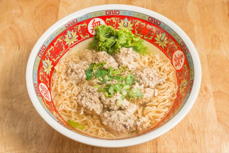 Close up of Instant noodle with meat ball and green Coriander on wood table. Close up of Instant noodle with meat ball and green Coriander royalty free stock photos