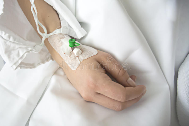 Close up of a intravenous drip in patient`s hand royalty free stock images