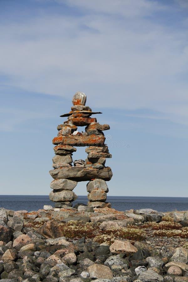 Close-up of Inukshuk Inuksuk landmark near Arviat, Nunavut. Traditional Inuit landmark near Arviat, Nunavut stock image