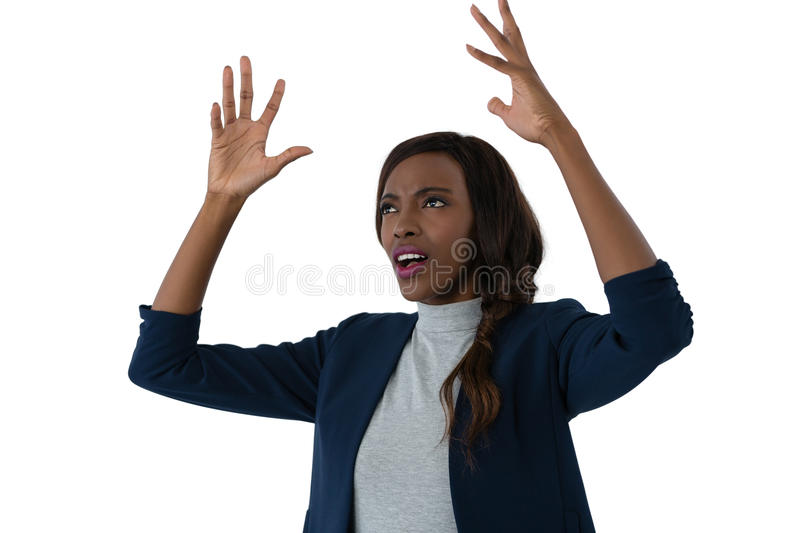 Close up of irritated businesswoman with hands on hip. Against white background stock images