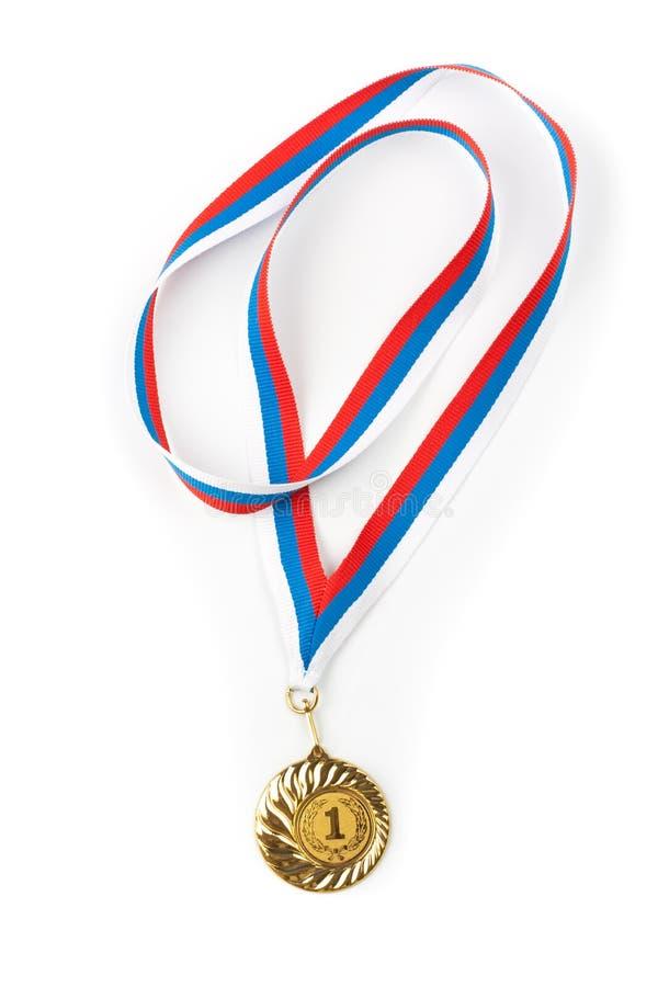 Close up isolado dourada ou de ouro da medalha fotografia de stock royalty free
