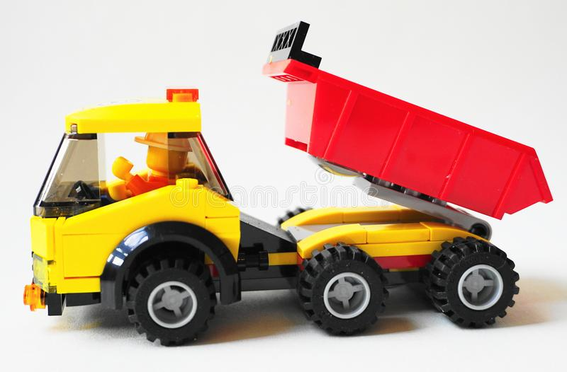 Close up isolated kids toy truck against white background. royalty free stock photography
