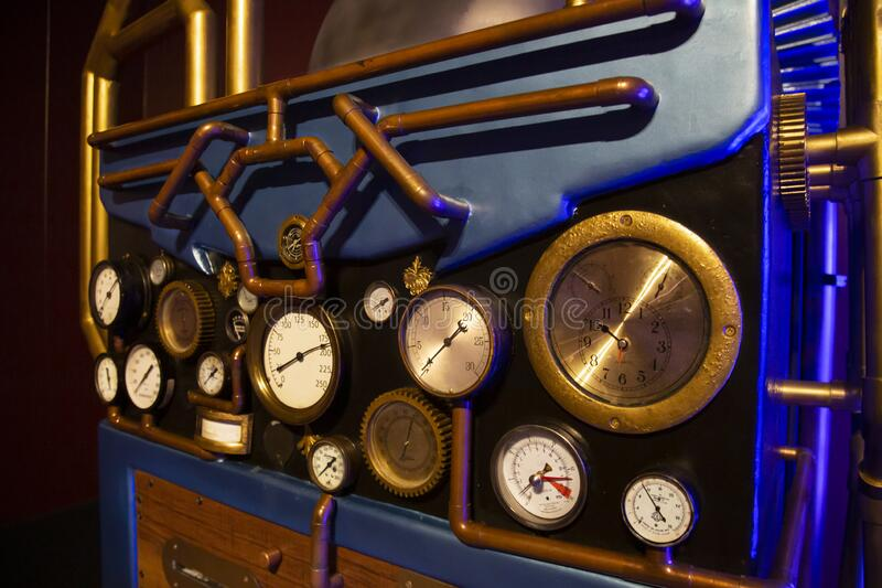 A close up, isolated view of multiple pipes and gauges royalty free stock photo