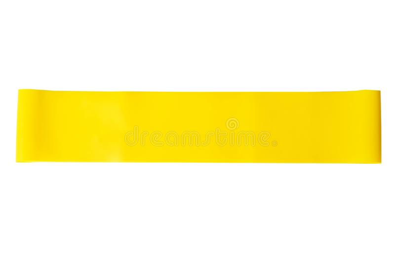 Close-up isolated yellow sport strap for stretching stock photo