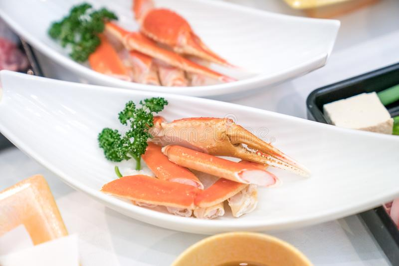 Close up Japanese claw and leg steamed crab on white dish, decorate with vegetable beside stock photos