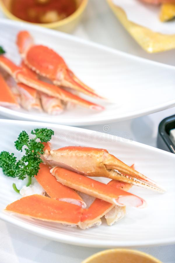 Close up Japanese claw and leg steamed crab on white dish, decorate with vegetable beside stock image
