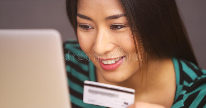 Close up of Japanese woman smiling with credit card royalty free stock photo