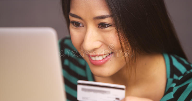 Close up of Japanese woman smiling with credit card stock images