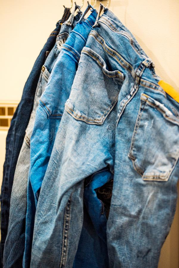 Close up of jeans on a rack stock photos