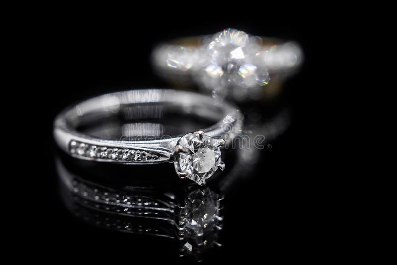 Jewelry diamond ring on black background with reflection stock photos