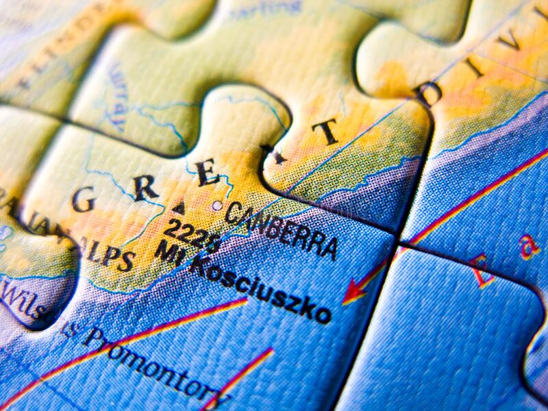Close up of a jigsaw puzzle map depicting Canberra and Australia. Close up image of a jigsaw puzzle map depicting Canberra and Australia. World integrity and stock photo