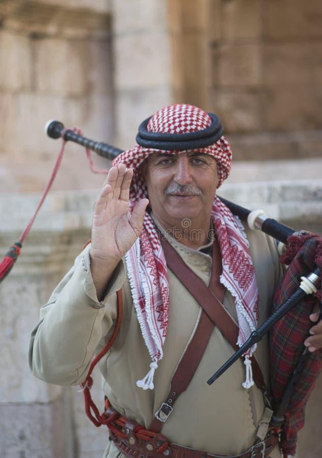 Close up of Jordanian military bagpipe player royalty free stock photo