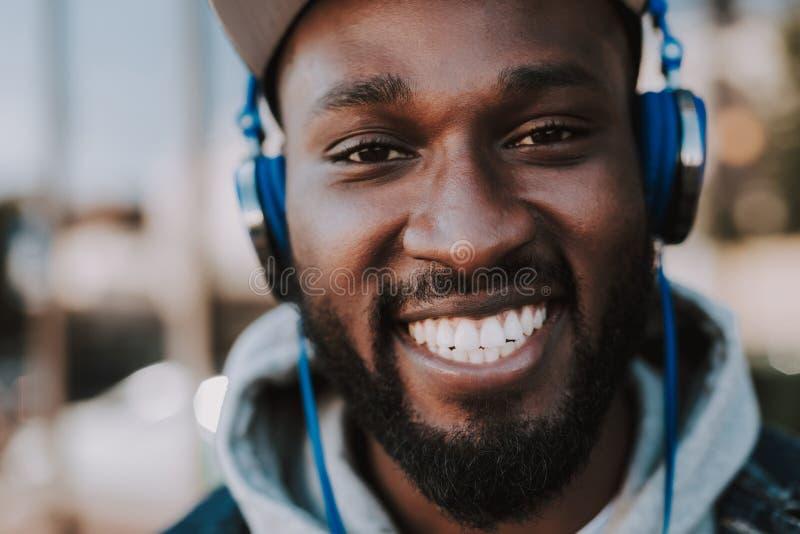 Close up of joyful afro american man wearing headphones royalty free stock photo