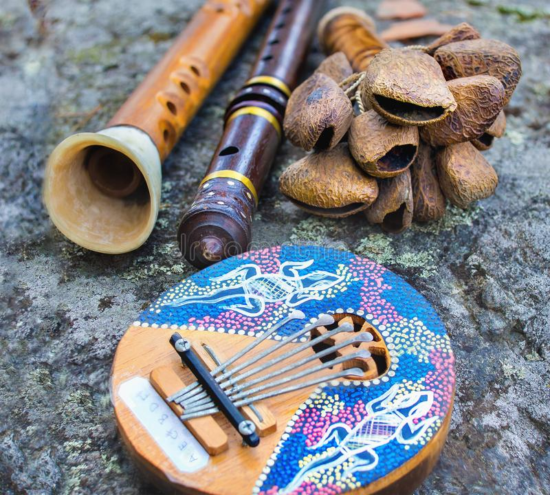 Close up of kalimba, rattle, flute and horn pipe music instruments royalty free stock photo