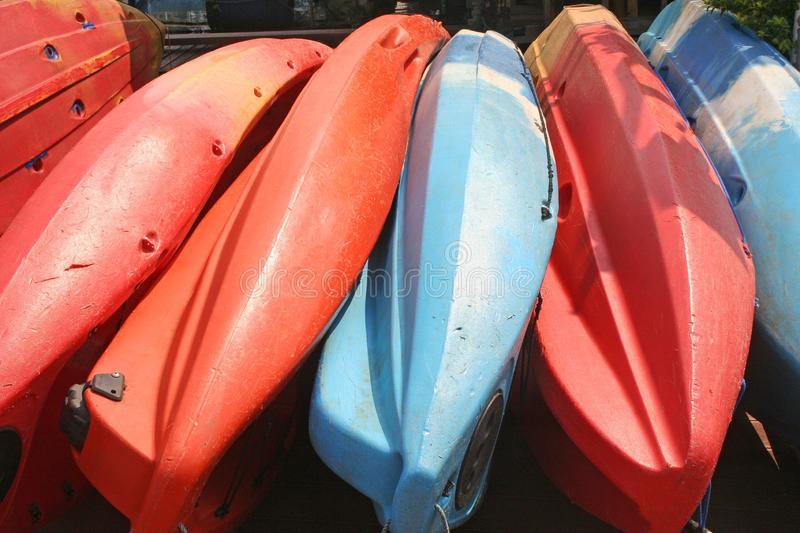 Kayaks or canoes piled on the floor royalty free stock photos