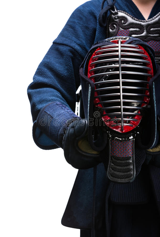 Close up of kendo helmet in hands of kendoka royalty free stock photo