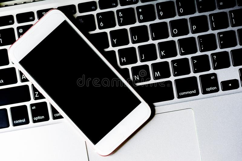 Close up of a keyboard computer with phone and tablet background stock photo