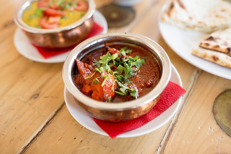 Close up of kidney bean masala in bowl on table. Food, south asian cuisine, culinary and cooking concept - close up of kidney bean masala in bowl on table of royalty free stock image