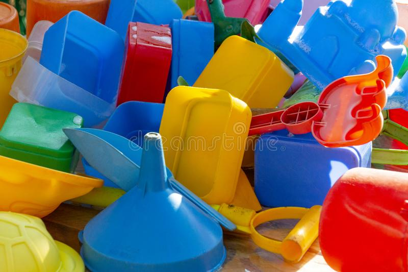 Kids Plastic Toys. A close up of kids colourful plastic toys that have been washed drying in the sun stock image