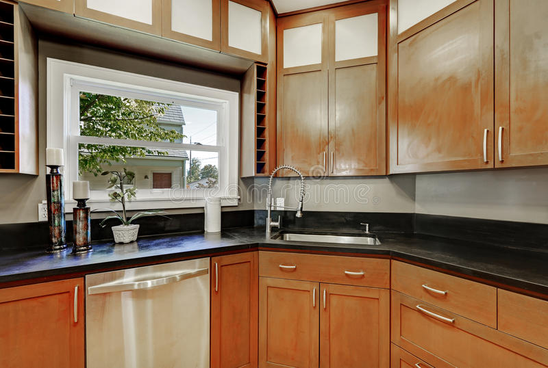Close Up Of Kitchen Cabinets, Black Counter Top , Small ...
