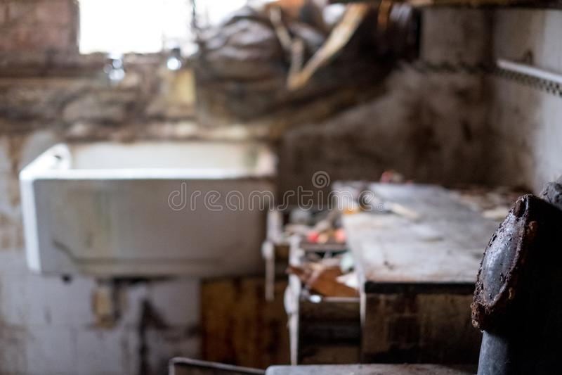 Close up of kitchen left in appalling condition in derelict 1930s deco house. Rayners Lane, Harrow UK. Close up of kitchen left in appalling condition in royalty free stock images