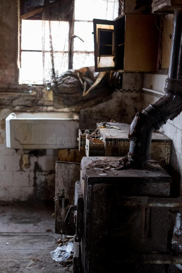 Close up of kitchen left in appalling condition in derelict house. Harrow UK. Close up of kitchen left in appalling condition in derelict house, Rayners Lane royalty free stock photo