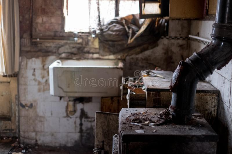 Close up of kitchen left in appalling condition in derelict house. Rayners Lane, Harrow UK. Close up of kitchen left in appalling condition in derelict house stock photos