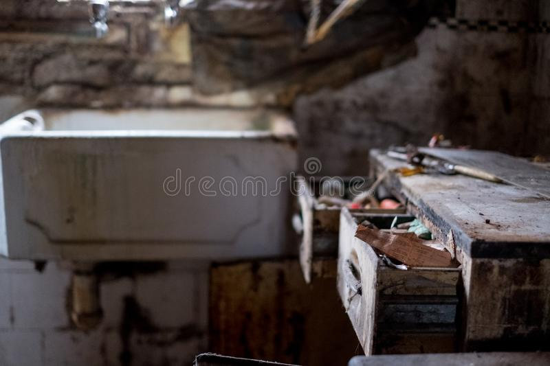 Close up of kitchen left in appalling condition in derelict 1930s deco house. Rayners Lane, Harrow UK. Close up of kitchen left in appalling condition in royalty free stock photo