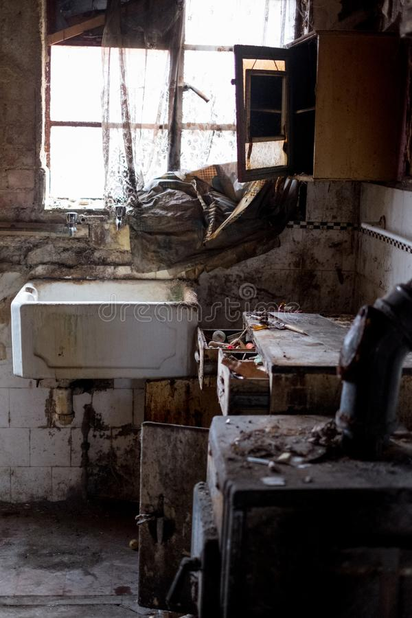 Close up of kitchen left in appalling condition in derelict house. Rayners Lane, Harrow UK. Close up of kitchen left in appalling condition in derelict house royalty free stock image