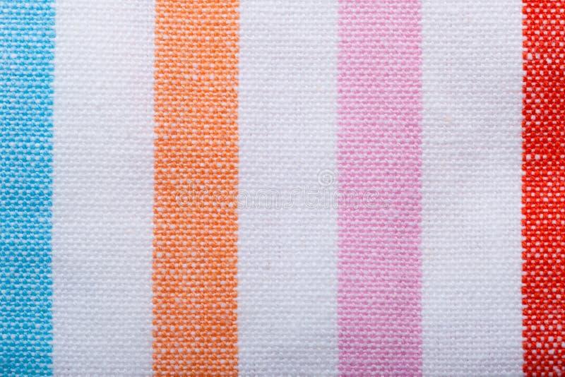 Close-up kleurrijke gestreepte textiel als achtergrond of textuur royalty-vrije stock afbeelding