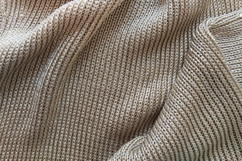 Close-up knitted golden silk fabric. Texture abstract background pattern stock image