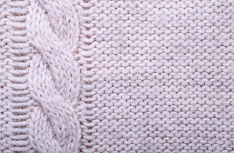 Knit Texture Of White Wool Knitted Fabric With Cable