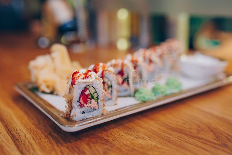 Close-up Kyoto eel smoked philadelphia Red Green dragon California ,Ebi Roll Rainbow Set rolls assorti in night dining restaurant. stock photo