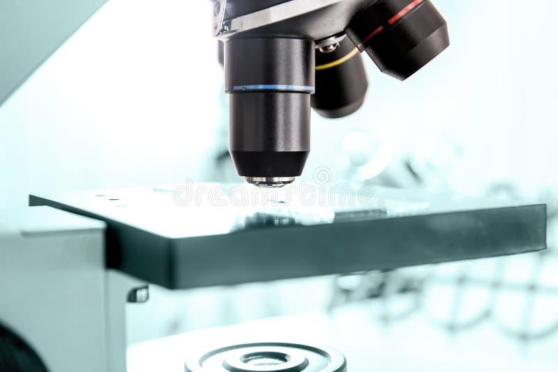 Close up of laboratory microscope lens stock photos