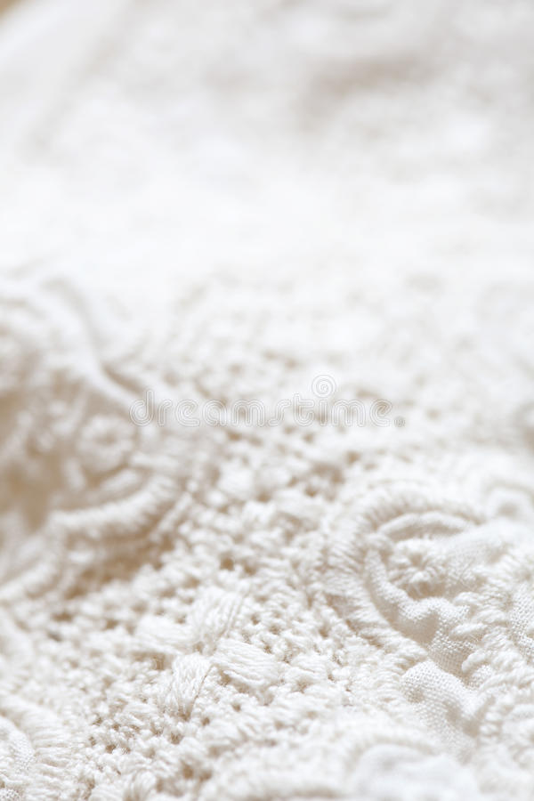 Close up of lacy pattern. Detail of pattern on white blanket, close up royalty free stock photography