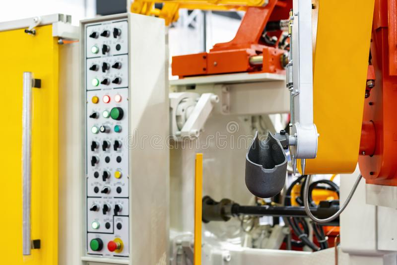 Close up ladle and mechanical arm of high pressure aluminum die cast machine and other detail such as control panel etc for. Automobile or vehicle part royalty free stock photography