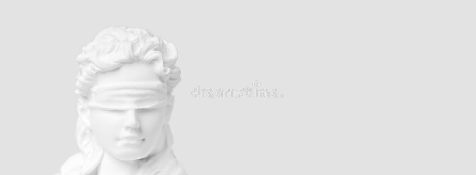 Close-up of lady justice. Close-up of lady justice figurine. Panoramic image with copy space royalty free stock photography