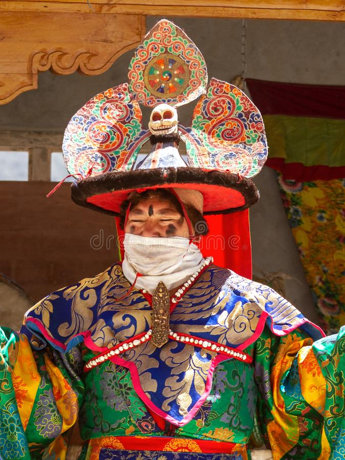 Close-up of Lama in ritual costume and ornate hat performs a historical mystery Black Hat Dance of Tibetan Buddhism on the Cham stock photo