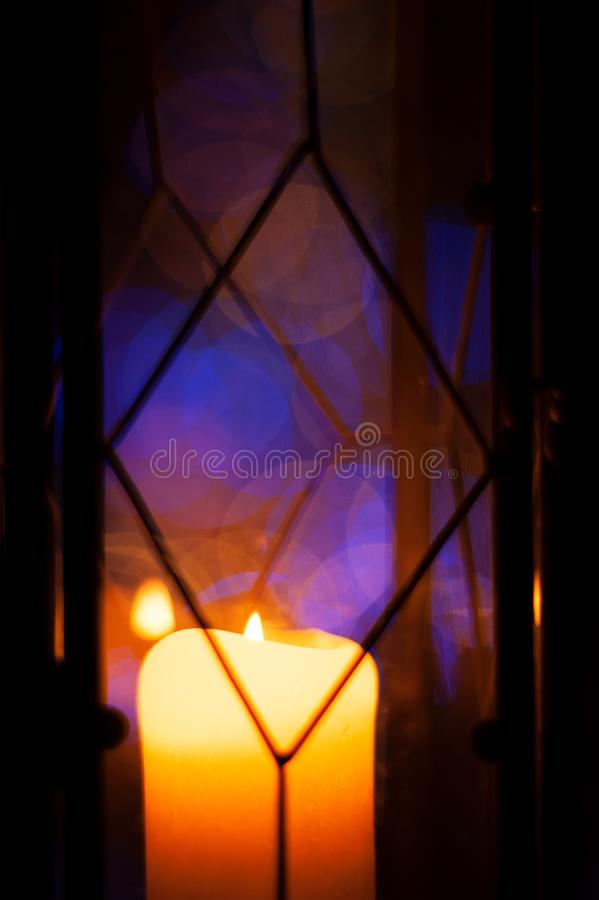 Close-up of lantern with yellow candle. Candle lantern close-up at dusk. Christmas time royalty free stock photo
